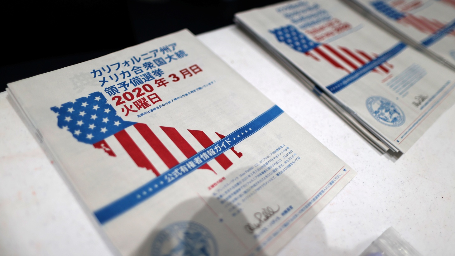 Voter guides in multiple languages are seen at a polling station on Super Tuesday in Santa Monica, California, U.S., March 3, 2020.