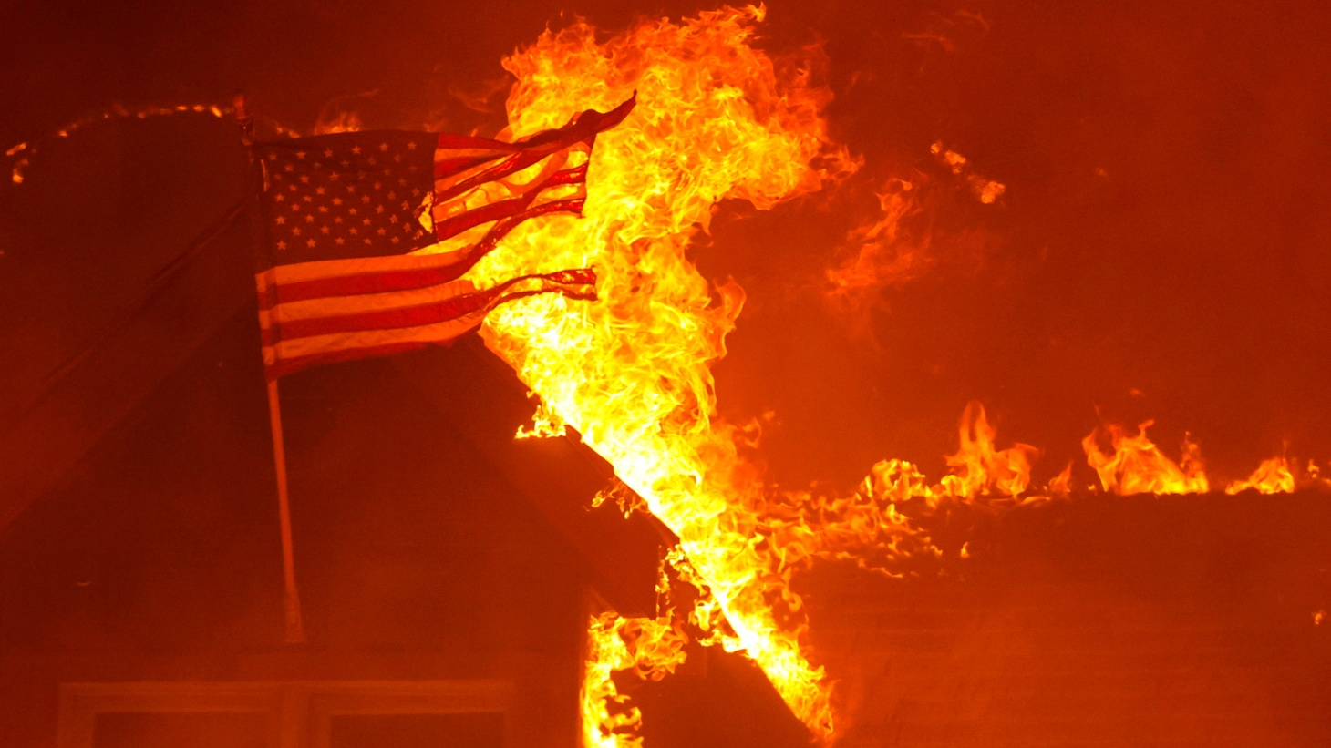 An American flag burns along with a cabin in the Caldor Fire near Phillips, California, U.S., August 29, 2021.