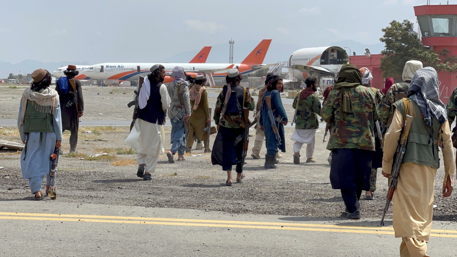 Taliban forces patrol at a runway a day after U.S troops withdrew from Hamid Karzai International Airport in Kabul, Afghanistan August 31, 2021.