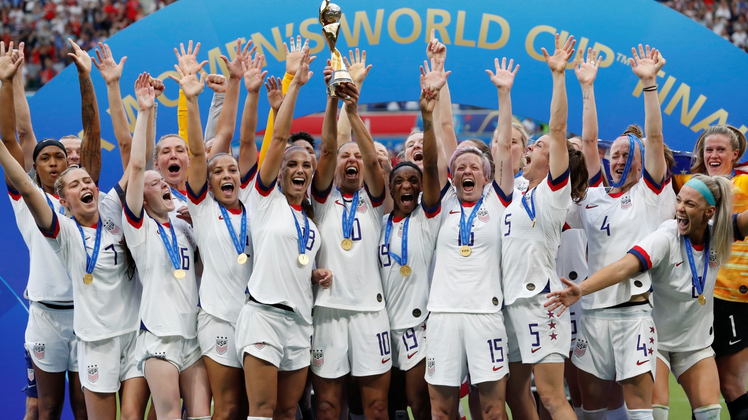 Carli Lloyd of the U.S. and teammates celebrate winning the Women's World Cup 2019 with the trophy. Groupama Stadium, Lyon, France. July 7, 2019.