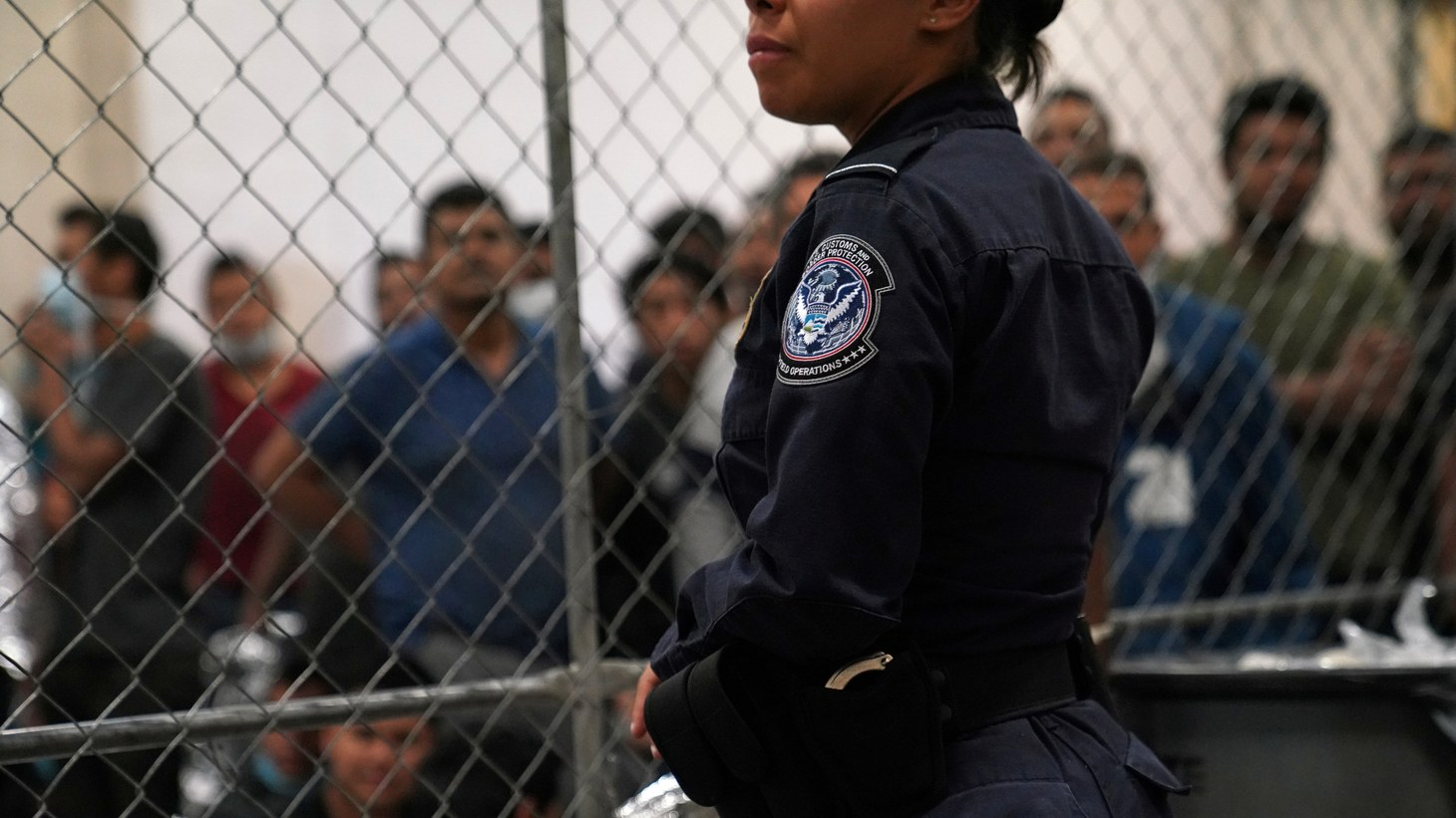 A U.S. Customs and Border Protection agent monitors single-adult male detainees at Border Patrol station in McAllen, Texas, U.S. July 12, 2019.