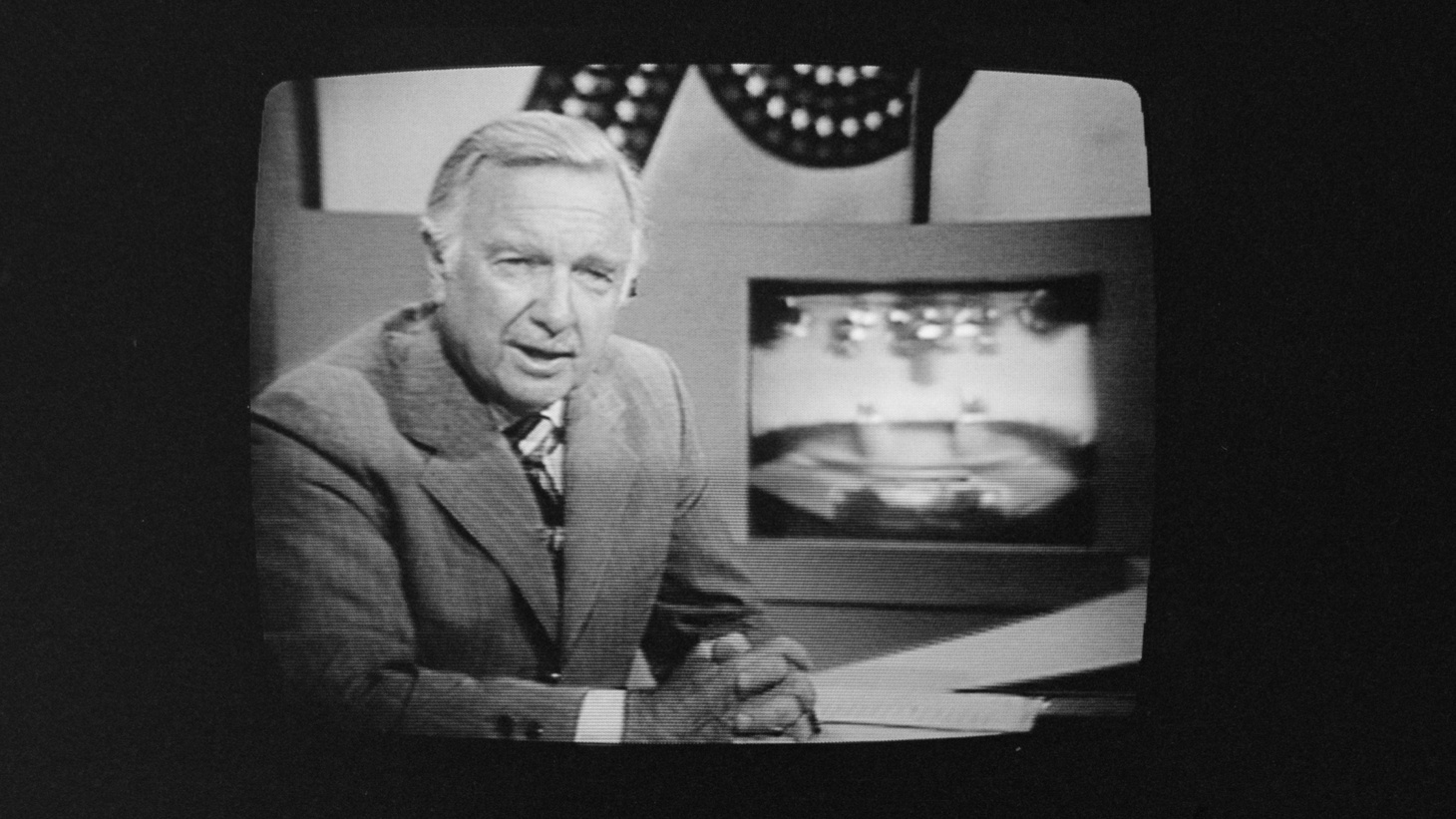 Walter Cronkite on television during Ford-Carter debate, 1976.