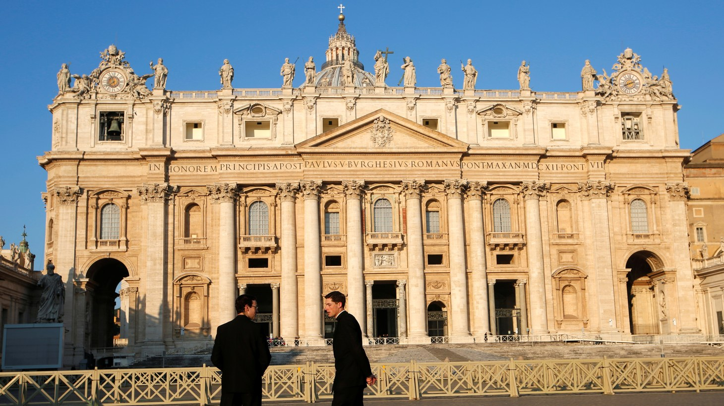 Two men talk in front of Saint Peter's Basilica ahead of a four-day meeting on the global sexual abuse crisis, held by Pope Francis, at the Vatican, February 21st, 2019.