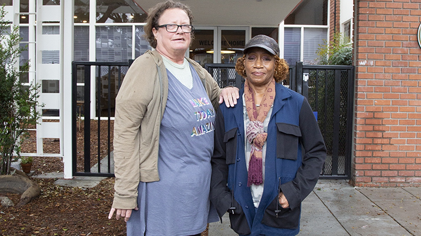 Christine Curtiss, left, in front of the Hollywood shelter she moved to last year, with her best friend and advocate Kym Moore.