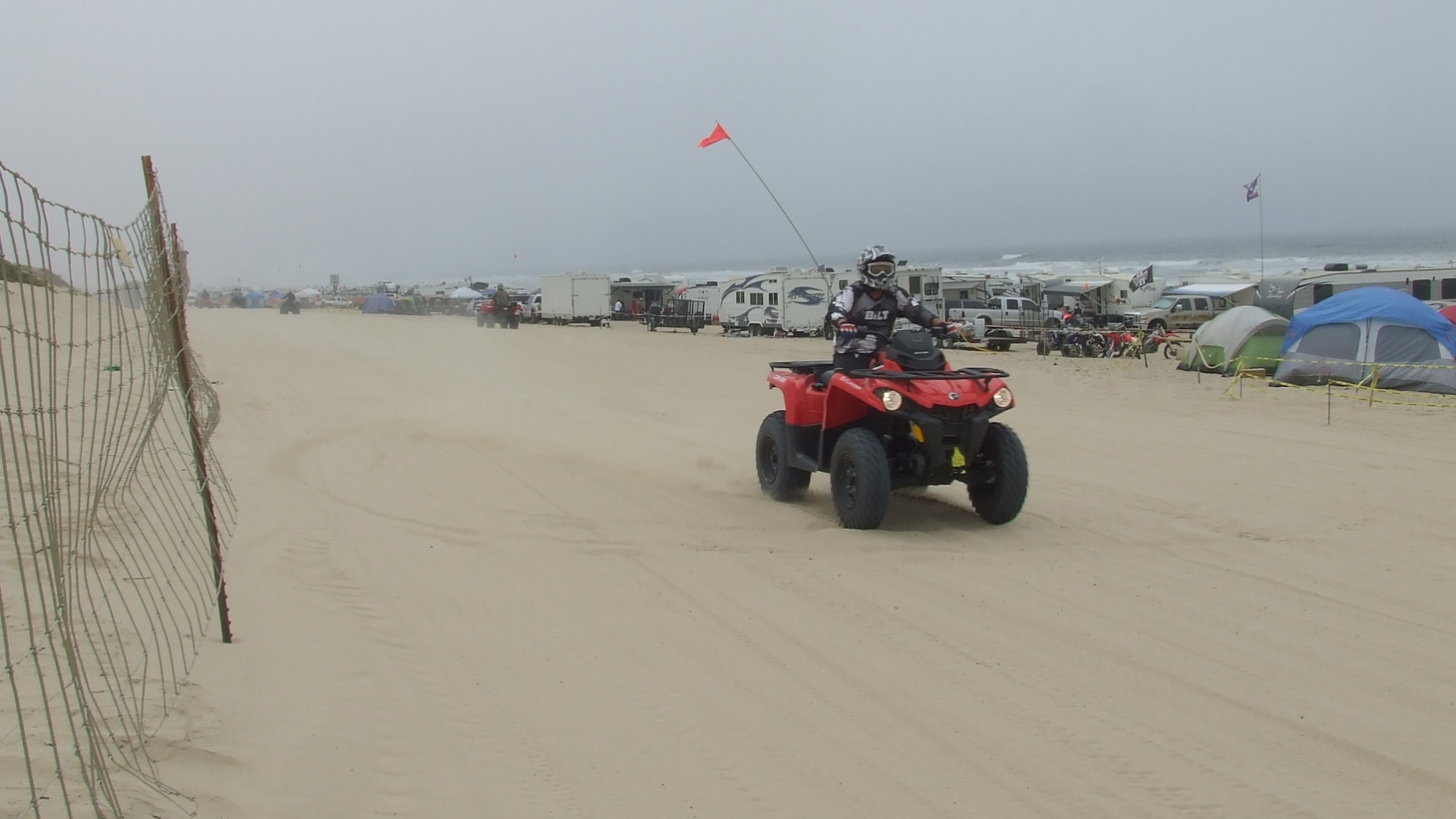 An ATV rider enjoys some sand racing at Oceano Dunes. This year, six people have died at the park with many others wounded.