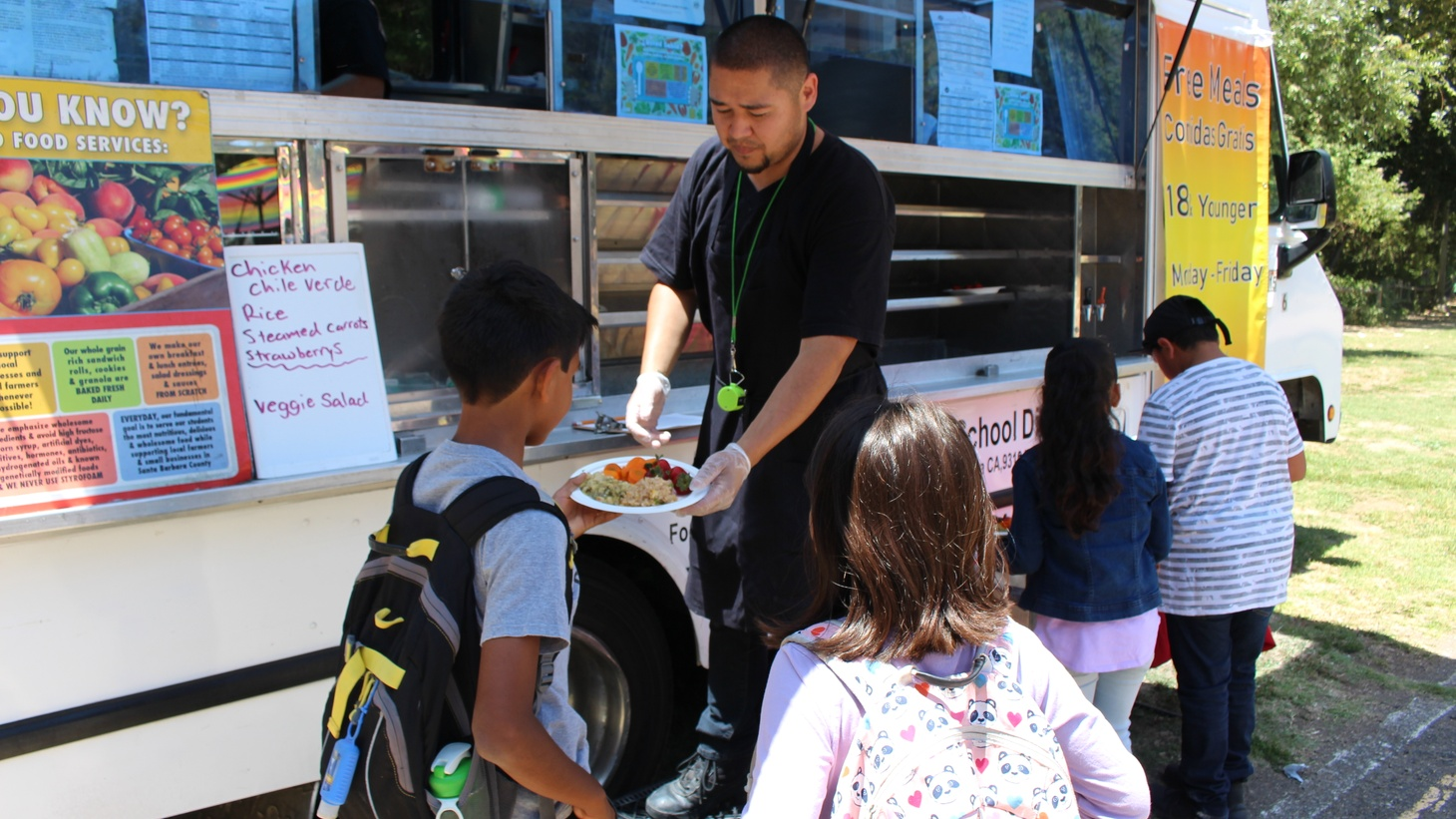 Local kids enjoy a healthy, free summer lunch at Bohnett Park from the Santa Barbara Unified School District's mobile kitchen. The program has seen a 55% decrease this year following the announcement of increased ICE raids.