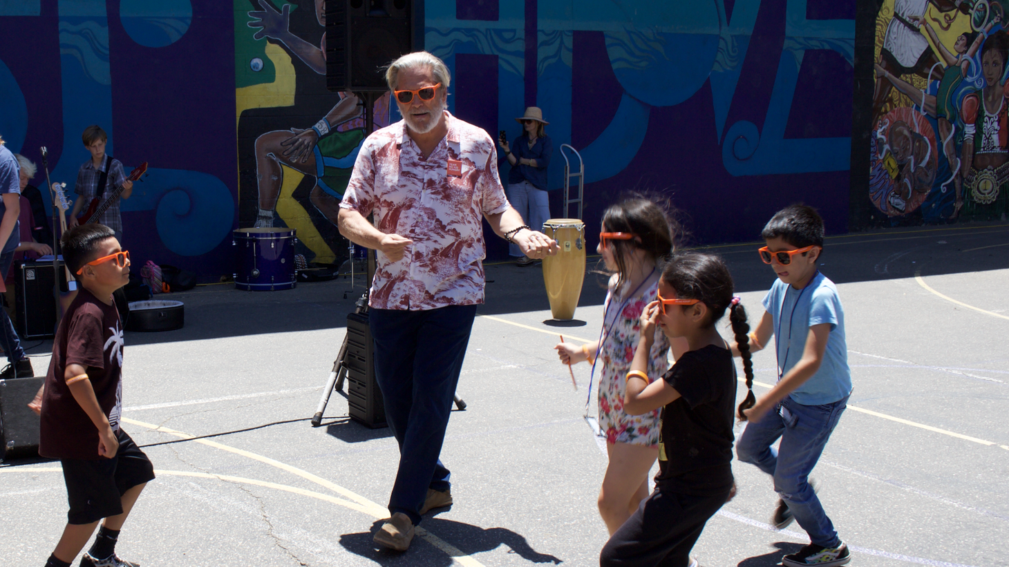 Actor and local resident, Jeff Bridges, dances with local kids as young musicians rock out to the classics.