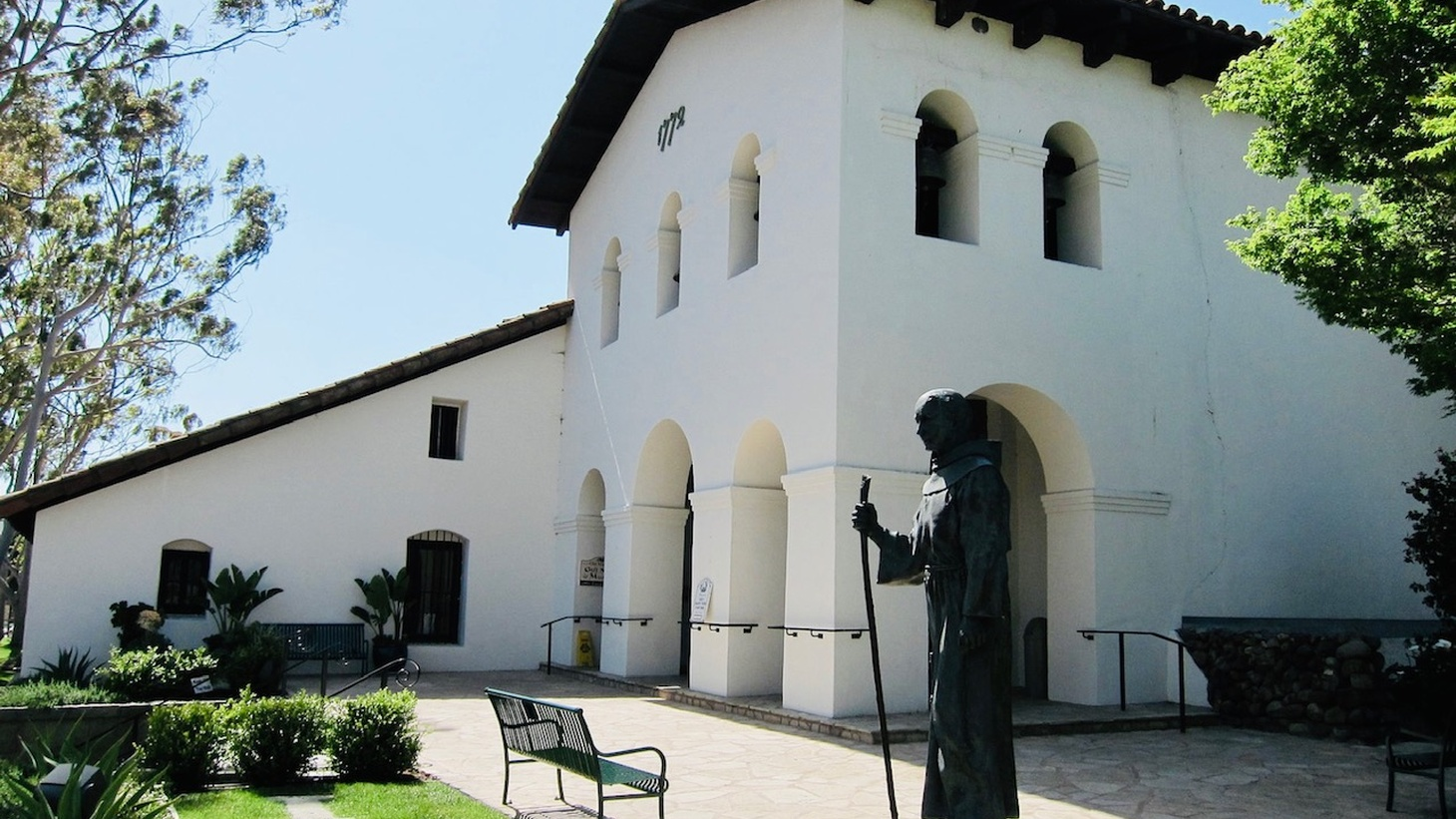 The Mission San Luis Obispo de Tolosa is home to a statue of Father Junipero Serra, a controversial figure city councilmembers are debating whether or not to honor.