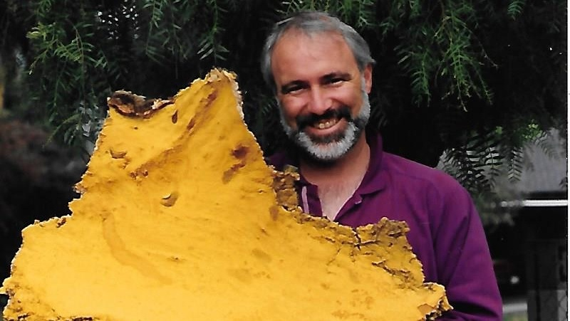 Antonio Gardella holds his find of large yellow spores.