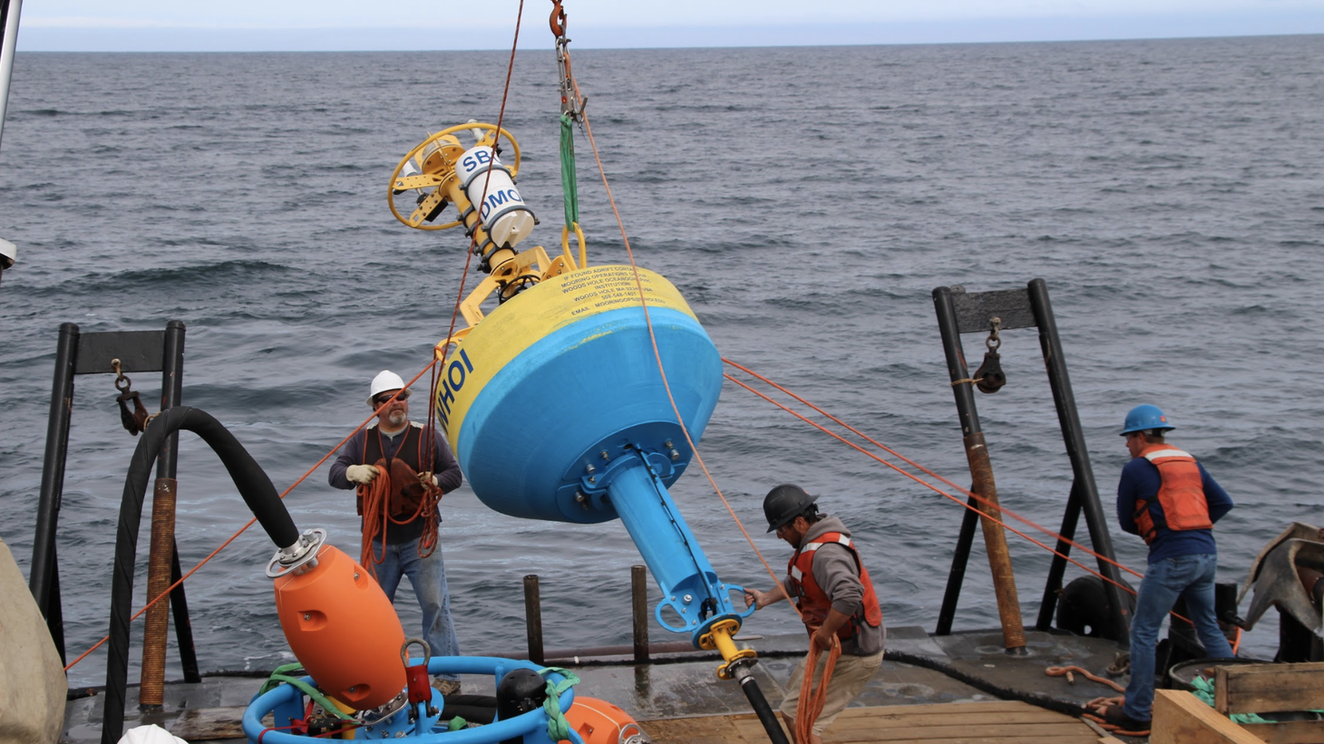 Scientists with the Benioff Ocean Initiative drop an underwater microphone designed to reduce whale deaths caused by cargo ship strikes in the Santa Barbara Channel.