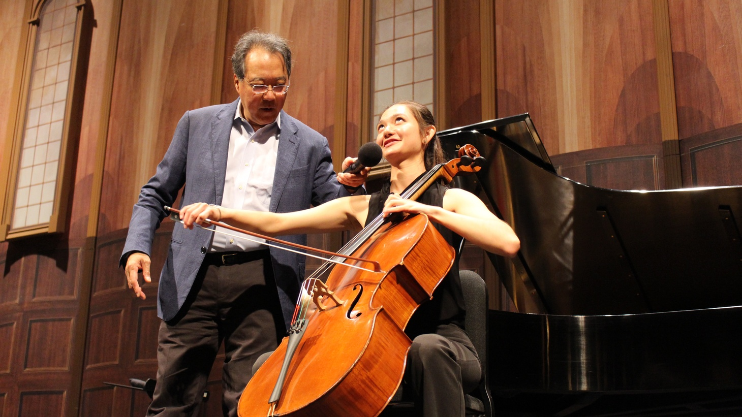 UCSB's electrical engineering undergraduate, Katrina Agate, takes stage instructions from revered cellist Yo-Yo Ma during a public master class.