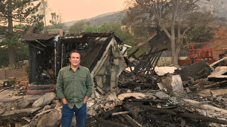Nick Bonge stands in front of his home of over 20 years, now burned to the ground.