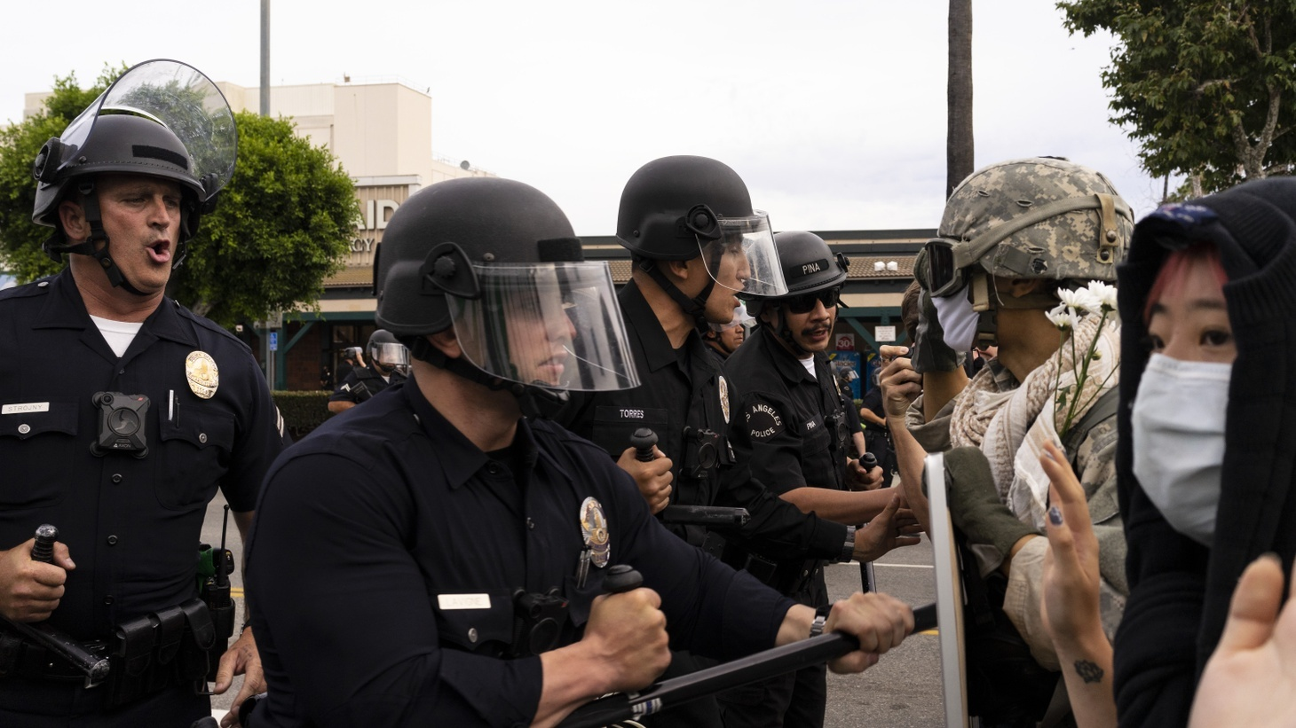At the intersection of Sunset and Vine, LAPD officers attempt to drive back a small group of protestors. Angelenos took to the streets to protest continued police violence in the wake of George Floyd's death by Minnesota police. June 1, 2020, Los Angeles.