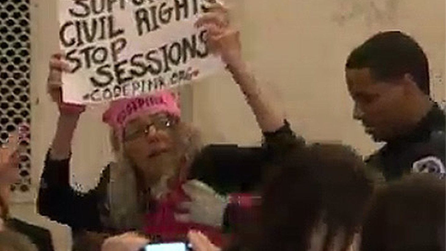 Back in January, when Attorney General Jeff Sessions was being confirmed by a Senate Committee, Alabama's Richard Shelby was commending Sessions' record. That brought a laugh from Desiree Fairooze, a 61-year-old Code Pink activist in a Statue of Liberty Hat, holding a protest sign.