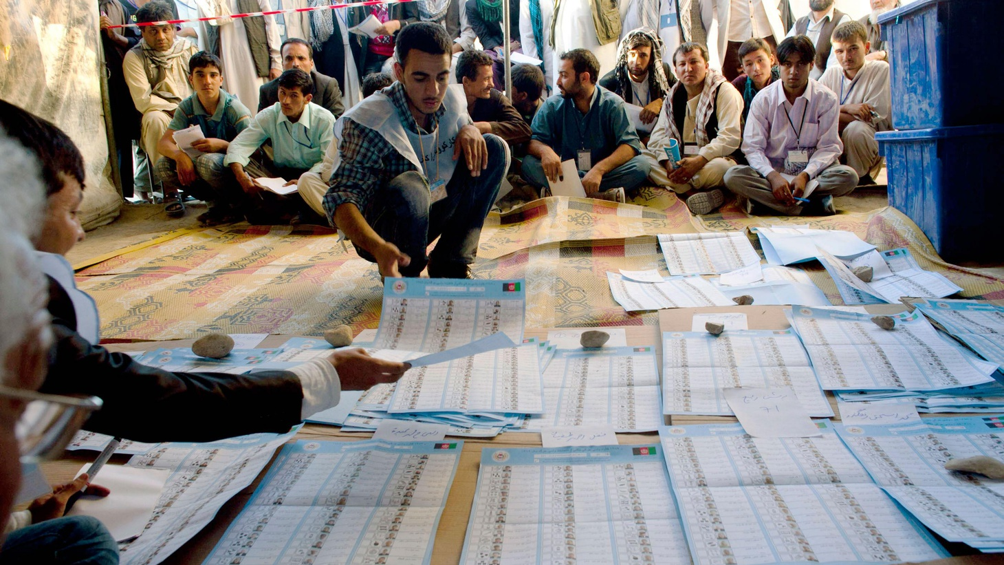 Afghan officials are still counting the votes from this weekend's parliamentary elections, marked by violence, a low turnout and widespread fraud.  What are the possible consequences for US policy with troop strength rising to nearly 100,000 troops. Also, the LA District Attorney brings charges against eight officials in the blue-collar city of Bell, and Britain's new government cracks down on bank bonuses.