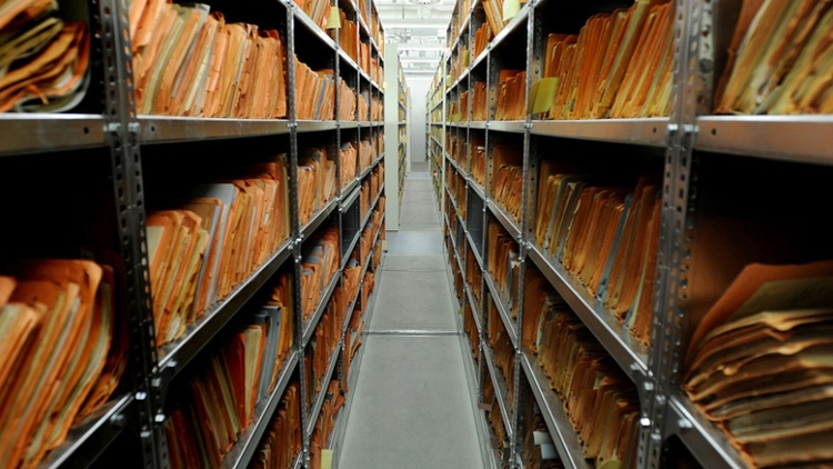 Last month in Berlin, Warren visited the archives of Stasi, the Communist secret police of East Germany.