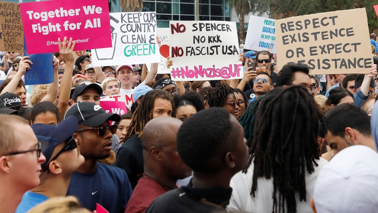 Demonstrators rally before the speech by Richard Spencer Photo by Shannon Stapleton/Reuters 