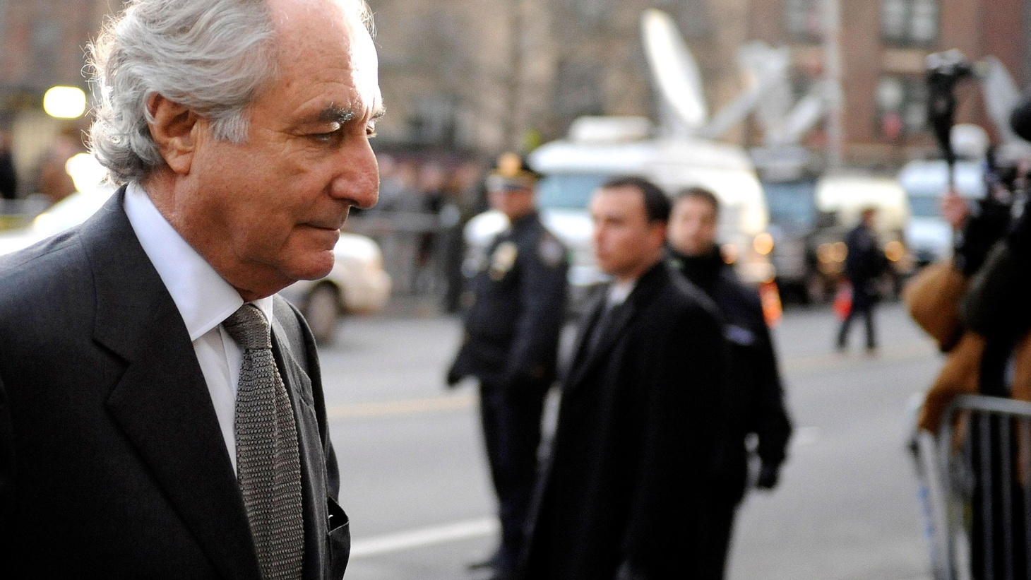 Bernard Madoff violated the trust and burned up the fortunes of 4800 people. He's likely to spend the rest of his life behind bars. But until now, has he been protected -- by a de-regulated financial system and a culture of greed? Also, the Iraqi shoe-thrower gets three years, and another Obama appointee steps down, this time from a high-level intelligence job.