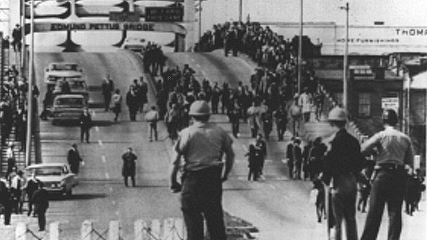 """On """"Bloody Sunday,"""" John Lewis and other civil rights marchers were brutally attacked by police and soldiers on the Edmund Pettus Bridge in Selma, Alabama."""