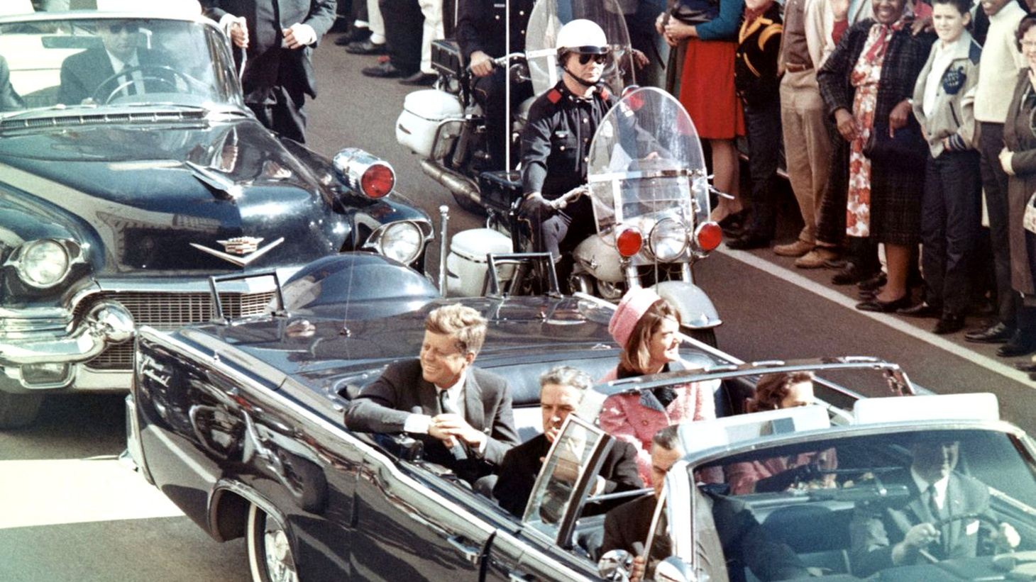 Picture of President Kennedy in the limousine in Dallas, Texas, on Main Street, minutes before the assassination, November 22, 1963.