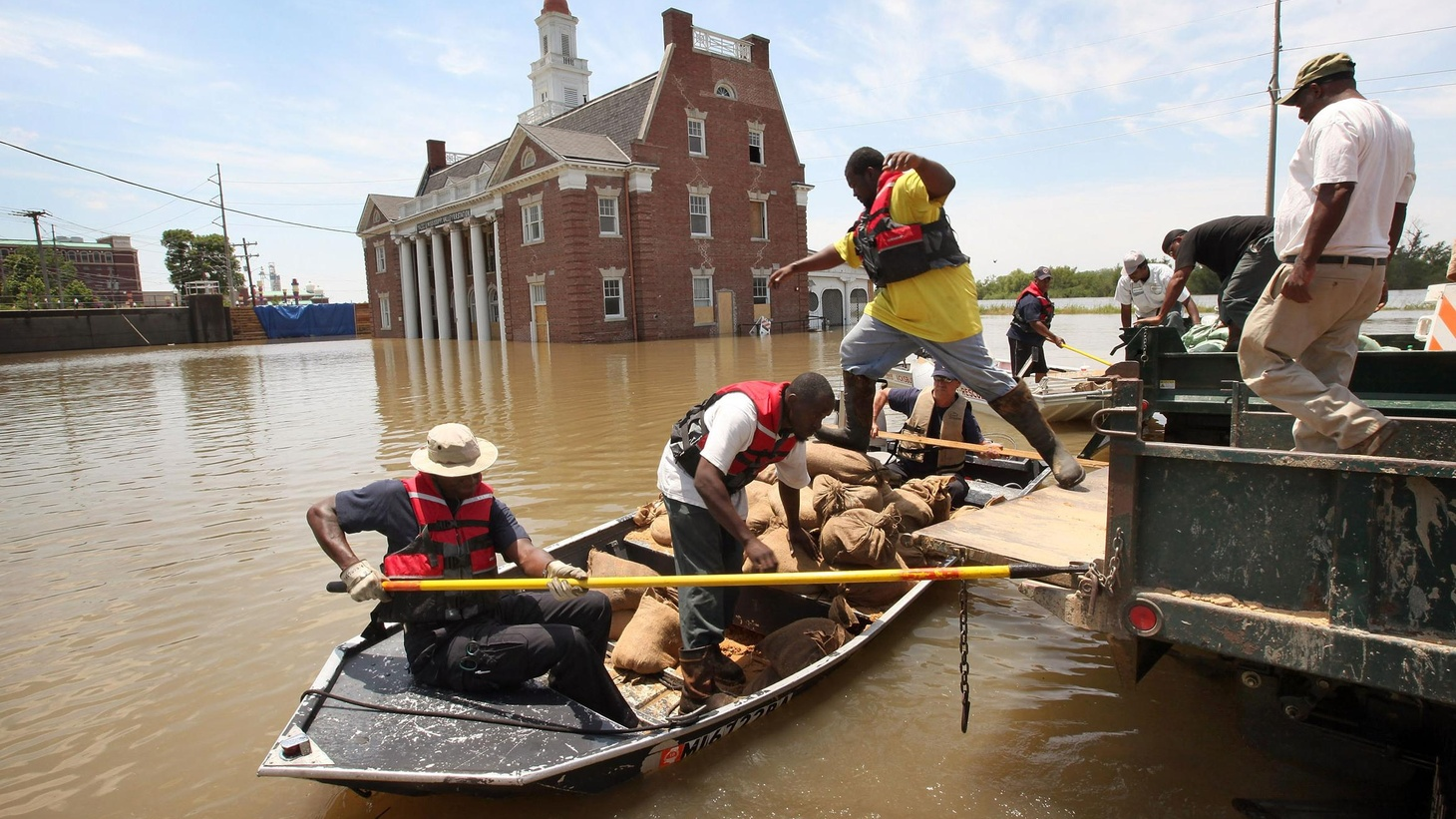 Record flooding on the Mississippi and its tributaries has led to choices between farmlands and heavily populated towns and cities. Downstream, there's much more to come.