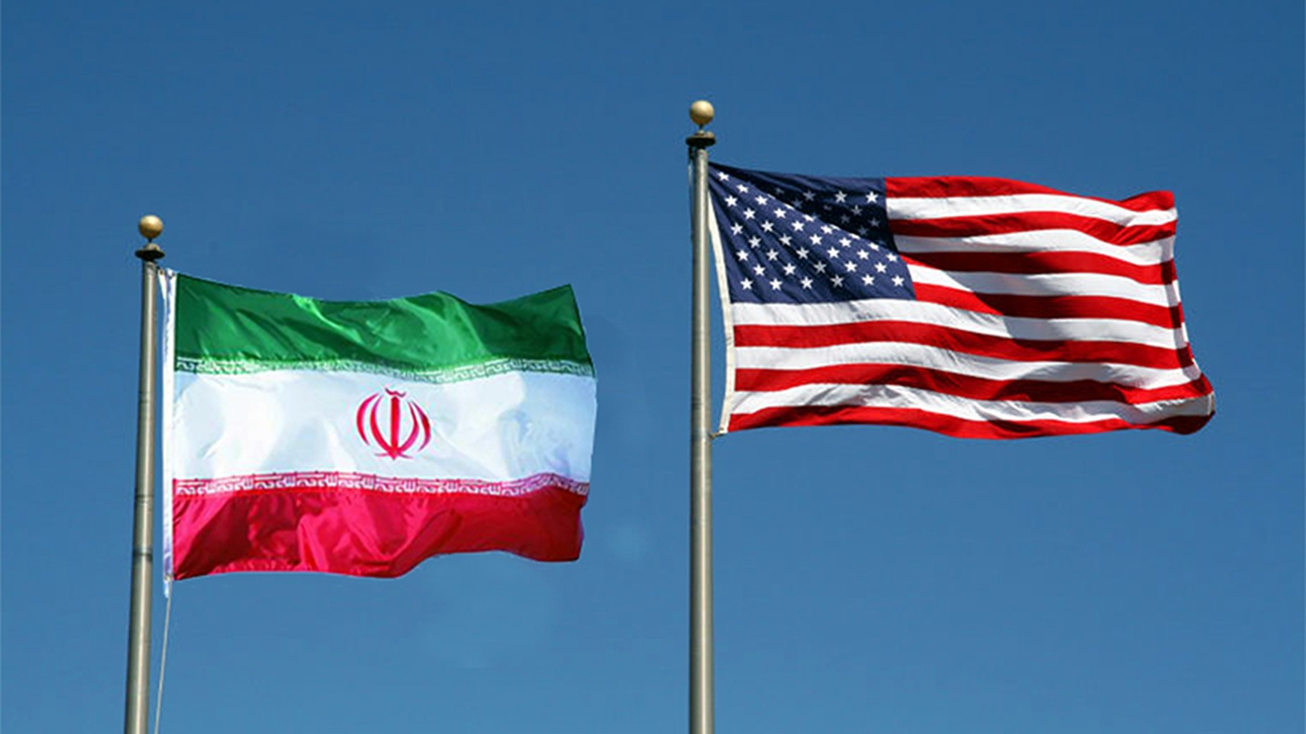 Iranian and US flags.