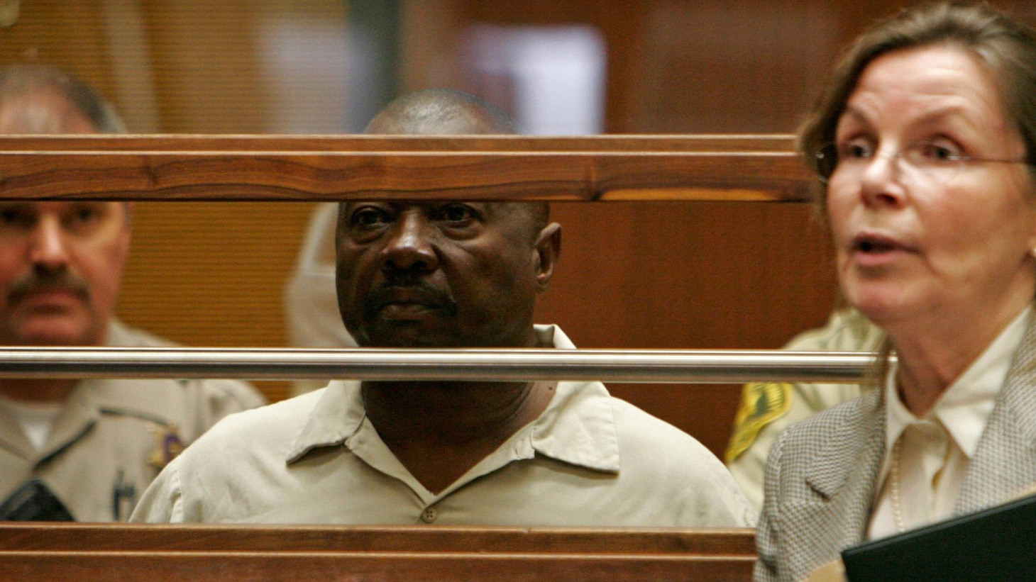 """Police in Los Angeles made an arrest in the 25-year-old serial murder case of the """"Grim Sleeper."""" The breakthrough came as the result of a search that's commonly called """"familial"""" DNA, a controversial practice in tracking down criminals. What privacy issues does it raise, and how certain are the results? Also, the finance bill moves closer to passage as Obama's poll numbers decline, and a look back at the life of one of baseball's larger-than-life managers. Sara Terry sits in for vacationing Warren Olney."""