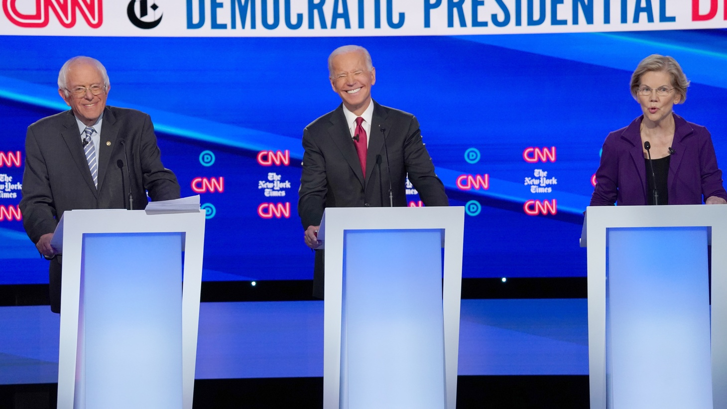 Democratic presidential candidate Senator Bernie Sanders and former Vice President Joe Biden listen to Senator Elizabeth Warren as they debate during the fourth U.S. Democratic presidential candidates 2020 election debate in Westerville, Ohio, U.S., October 15, 2019.