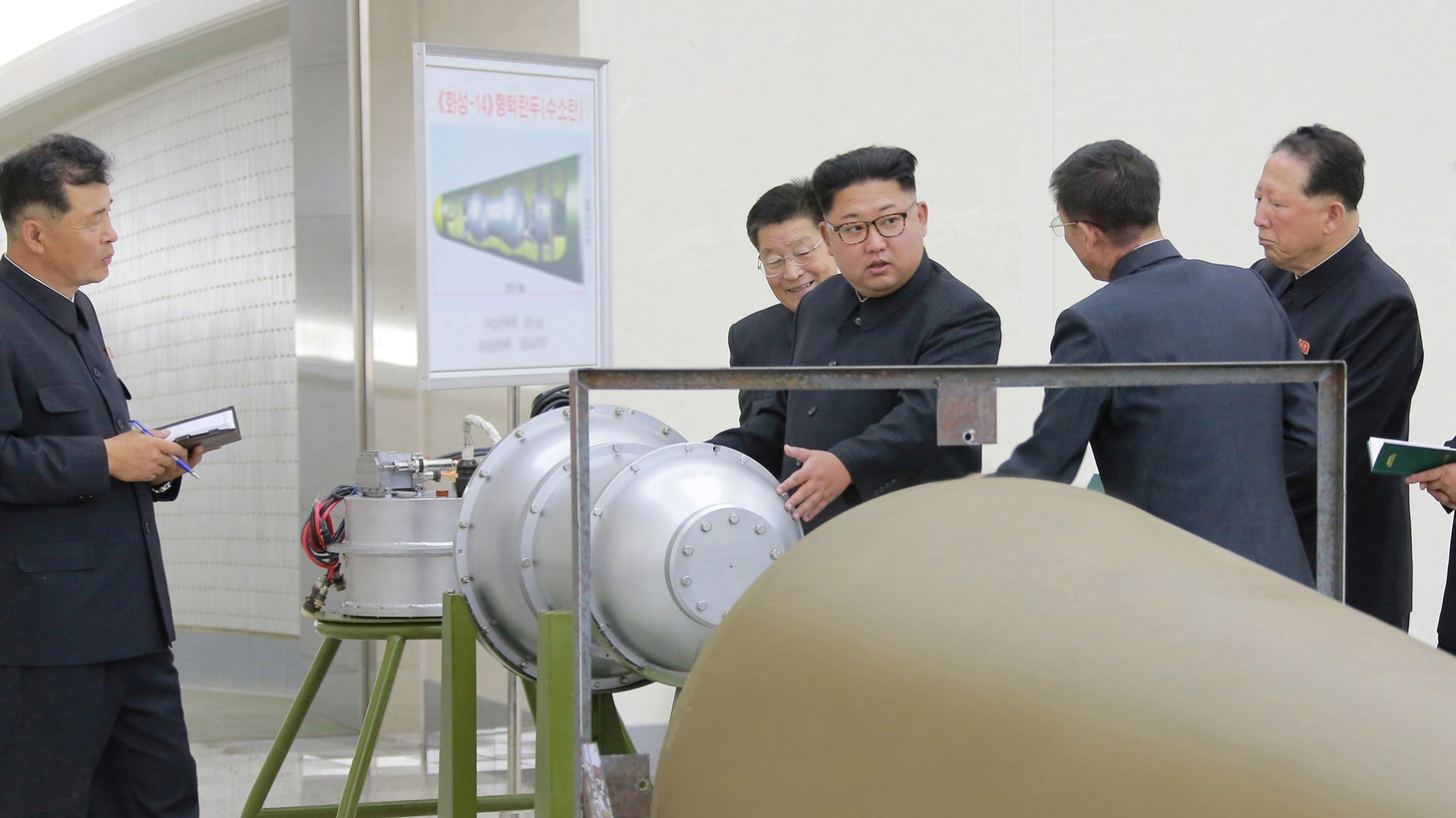 North Korean leader Kim Jong Un provides guidance with Ri Hong Sop (2nd L) and Hong Sung Mu (2nd R) on a nuclear weapons program in this undated photo released by North Korea's Korean Central News Agency in Pyongyang September 3, 2017.