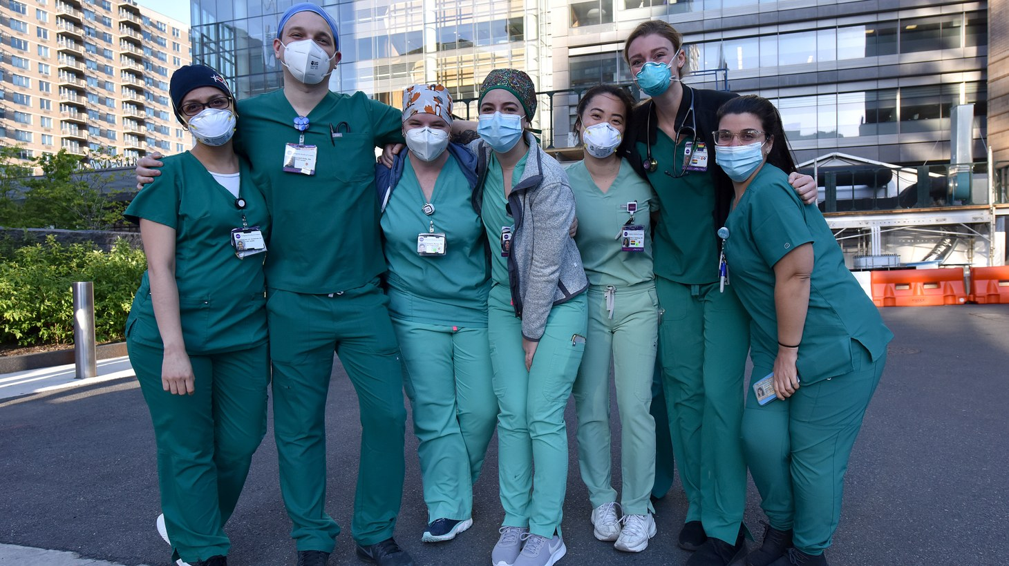 Nurses pose outside NYU Langone Medical Center during the nightly 7pm applause and cheers in honor of frontline medical workers during the COVID-19 pandemic, in New York, NY, May 13, 2020
