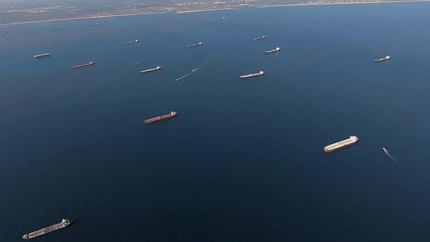 Some of the 27 oil tankers anchored off shore during the outbreak of the coronavirus disease (COVID-19) are viewed from a U.S. Coast Guard helicopter near Long Beach, California, U.S., in a still image from video taken April 23, 2020. Image taken April 23, 2020.