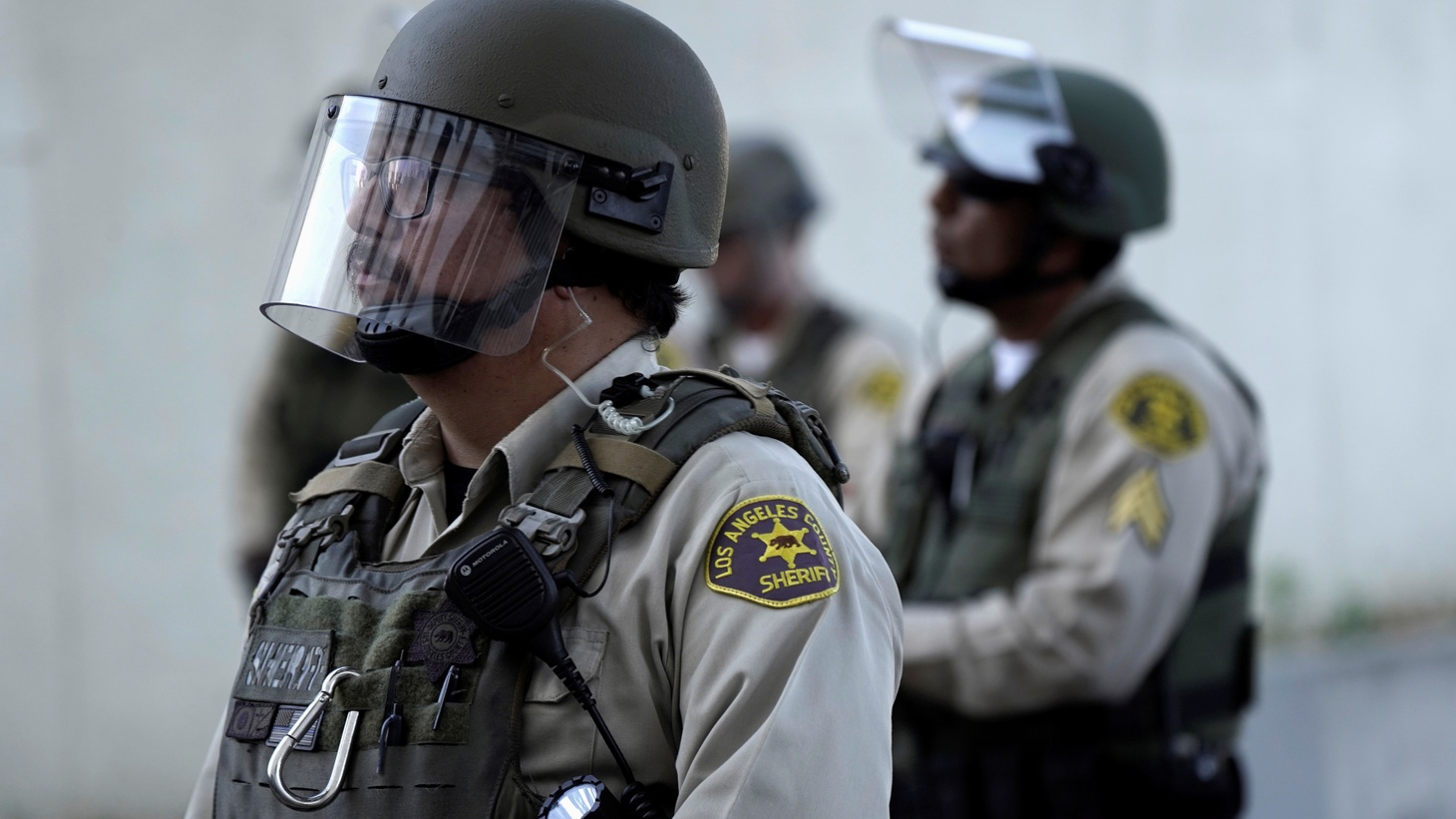 Los Angeles County Sheriff's Department deputies, in riot gear, watch a protest over racial injustice and the Gardena fatal shooting of 18 year-old security guard Andres Guardado, in Compton, California, U.S., June 21, 2020.
