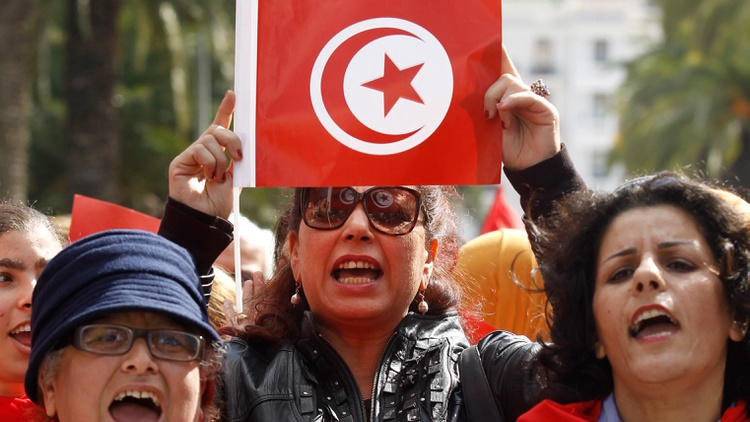 A Tunisian woman holds up a flag during a march to celebrate International Women's Day in Tunis March 8, 2014 Photo by Zoubeir Souissi/Reuters   Tunisia has been a pioneer for women's…
