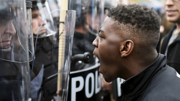 After last night's rioting, there is tension on the streets of Baltimore — filled with protesters, police and the National Guard.