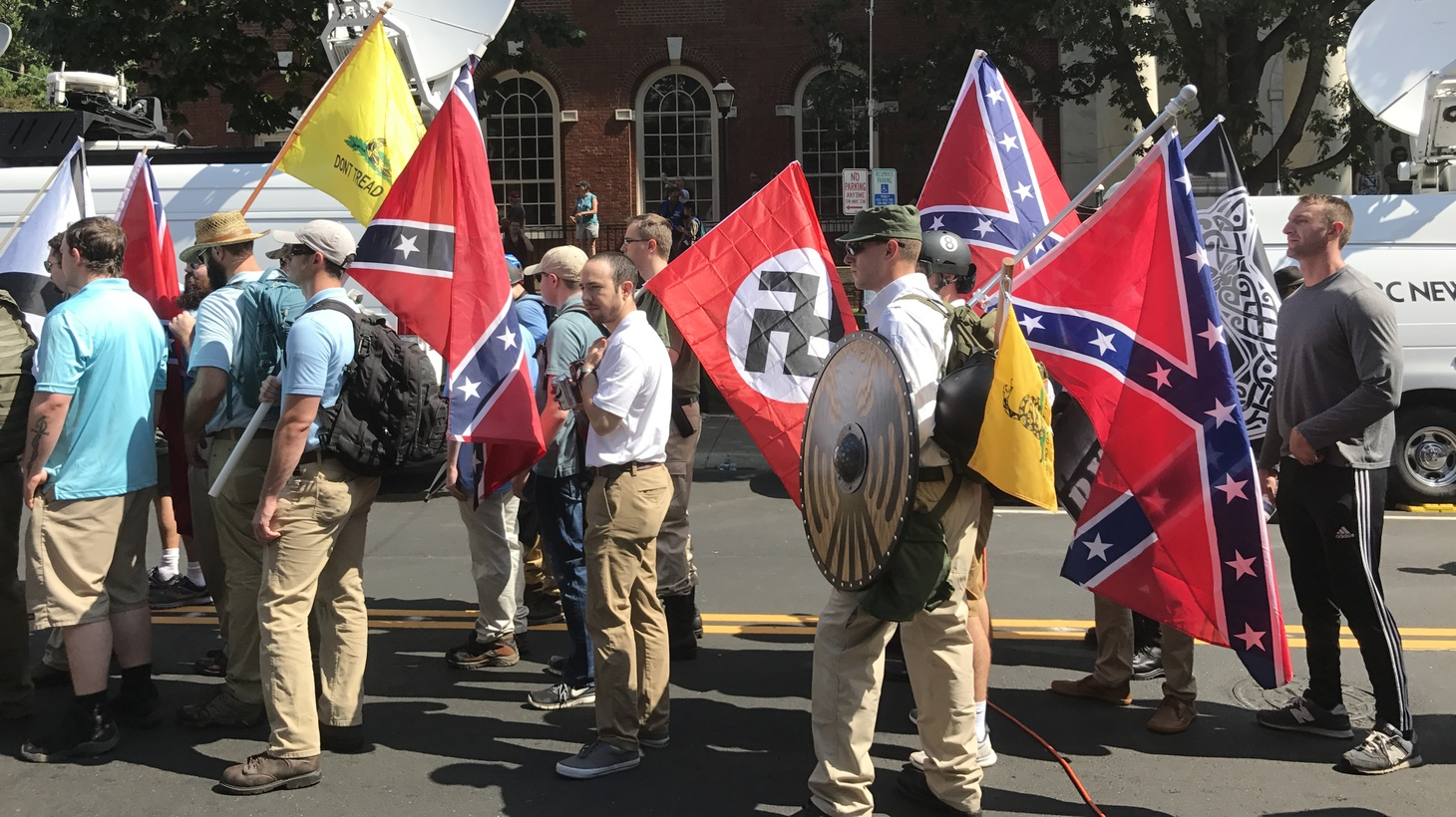"""Alt-right members preparing to enter Emancipation Park holding Nazi, Confederate, and Gadsden """"Don't Tread on Me"""" flags, August 2017."""