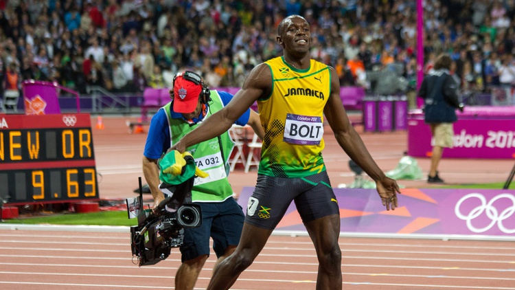 A photographer catches up with Bolt after his gold-medal win at the London's Olympics Photo by  Hilts uk  