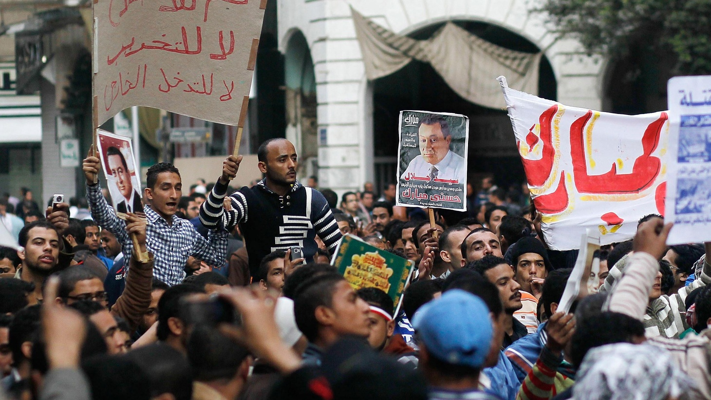 "After yesterday's bloody crackdown, Friday prayers were followed by an uneasy calm in Cairo's Tahrir Square.  The military has increased its presence, and visitors have included Defense Minister Marshal Mohamed Tantawi, who was cheered while reviewing the soldiers.  Protesters are still calling this the ""Day of Departure."" Also, a conversation with Amy Chua, author of Battle Hymn of the Tiger Mother, and some of her critics."