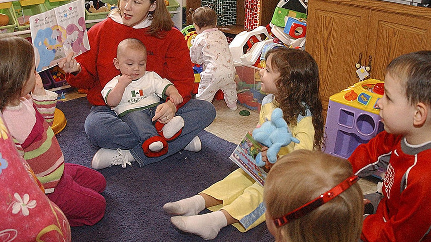 As childcare costs overwhelm young families, more women are staying home, and families are losing financial ground. Has the time come for federally funded daycare? Should employers step up with paid leave, flexible work hours, on-site preschool?