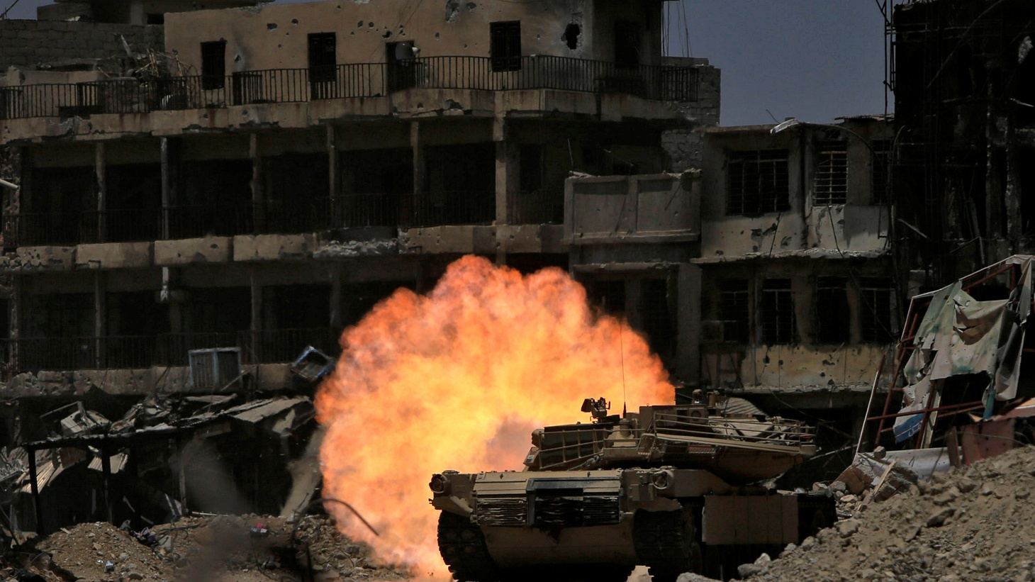 A tank of the Emergency Response Division fires at Islamic State militants in the old city of Mosul.