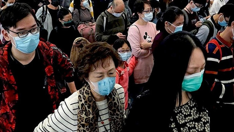 China has locked down an entire city to control the coronavirus, while President Trump has eliminated federal programs to cope with disease epidemics.