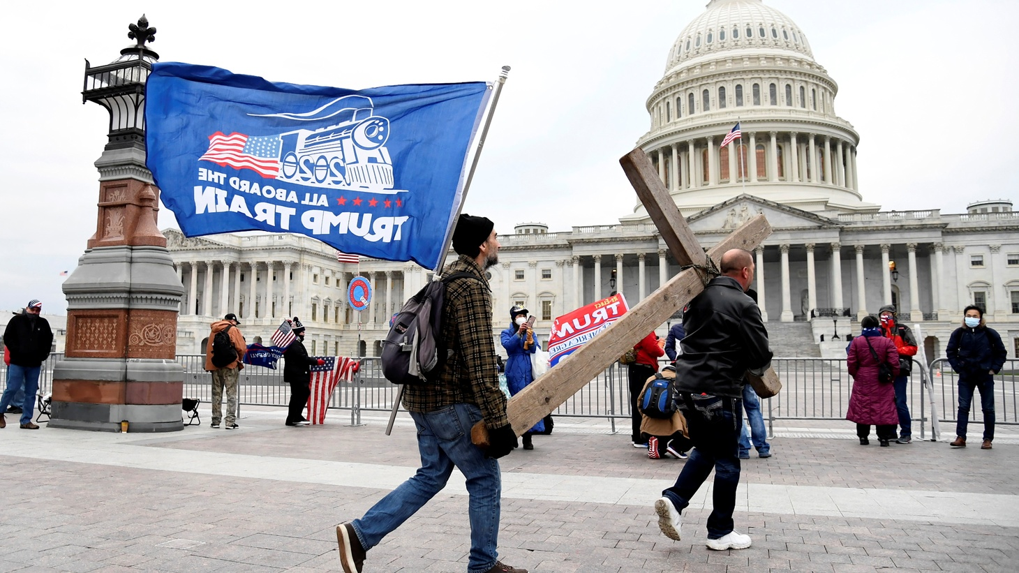 Jeremy LaPointe of Lumberton, Texas (R) carries a cross to a gathering of U.S. President Donald Trump supporters, outside the U.S. Capitol where Congress will meet in joint session to certify the electoral college vote for President-elect Joe Biden, in Washington, U.S., January 6, 2021.