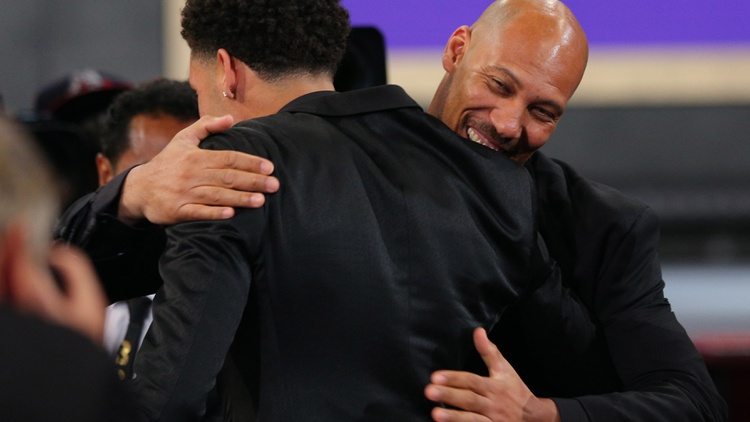 Lonzo Ball (UCLA) celebrates with his father LaVar Ball after being introduced as the number two overall pick to the Los Angeles Lakers in the first round of the 2017 NBA Draft at…