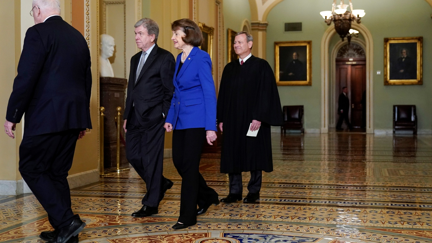 Chief Justice of the United States John Roberts follows Senators Patrick Leahy (D-VT), Roy Blunt (R-MO) and Barbara Feinstein (D-CA) as he arrives for the beginning of the impeachment trial of U.S. President Donald Trump on Capitol Hill in Washington, U.S., January 16, 2020.