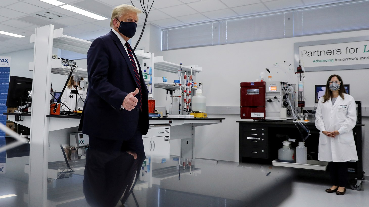U.S. President Donald Trump gestures during a tour of the Fujifilm Diosynth Biotechnologies' Innovation Center, a pharmaceutical manufacturing plant where components for a potential coronavirus disease (COVID-19) vaccine candidate are being developed, in Morrrisville, North Carolina, U.S., July 27, 2020.