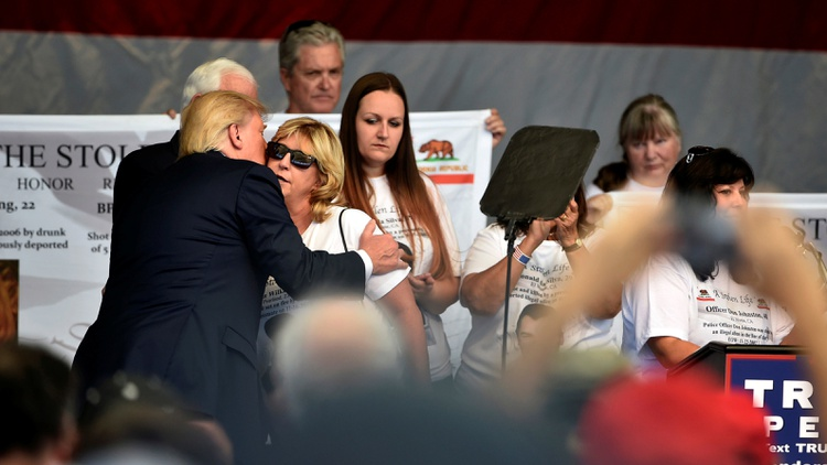 Republican presidential nominee Donald Trump embraces a member of The Remembrance Project at a campaign rally in Henderson, Nevada October 5, 2016 Photo by David Becker/Reuters  …