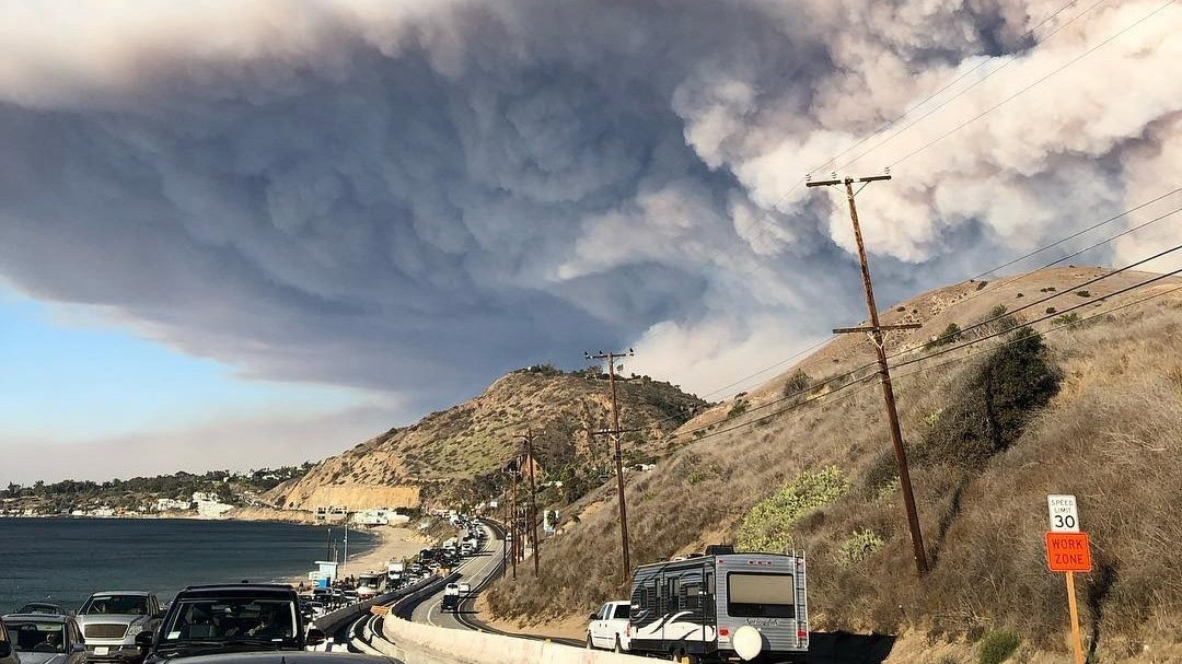 The smoke plume from the fast-moving Woolsey Fire encroaching on Malibu on November 9, 2018, as residents evacuate along the Pacific Coast Highway.