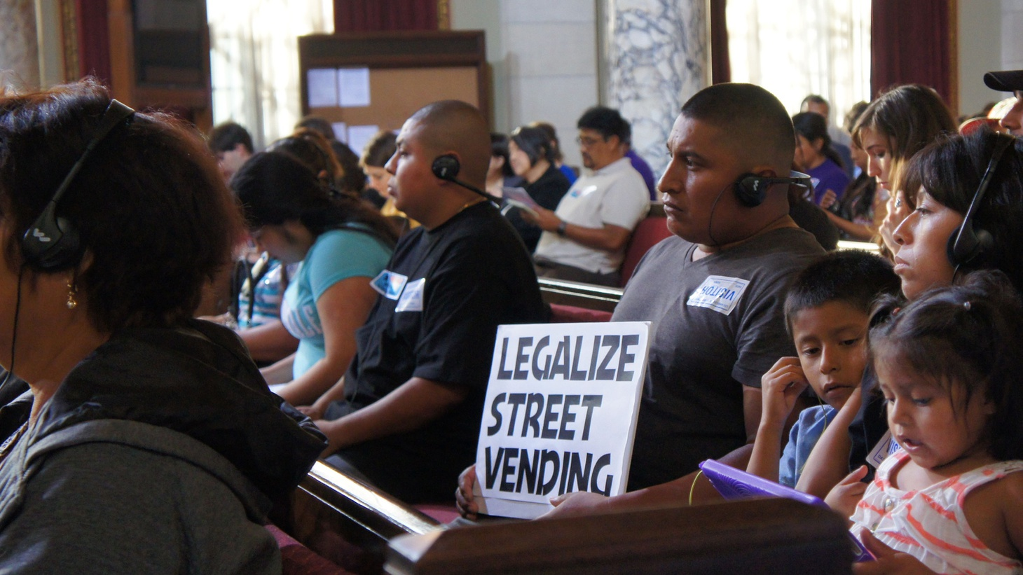 In South Los Angeles tonight, city officials are hosting the last in a series of hearings that have attracted big crowds: what to do about thousands of merchants who sell food and other merchandise on the streets… without permits. Venders and their allies want the trade to be permitted, but some business owners don't like the idea at all.