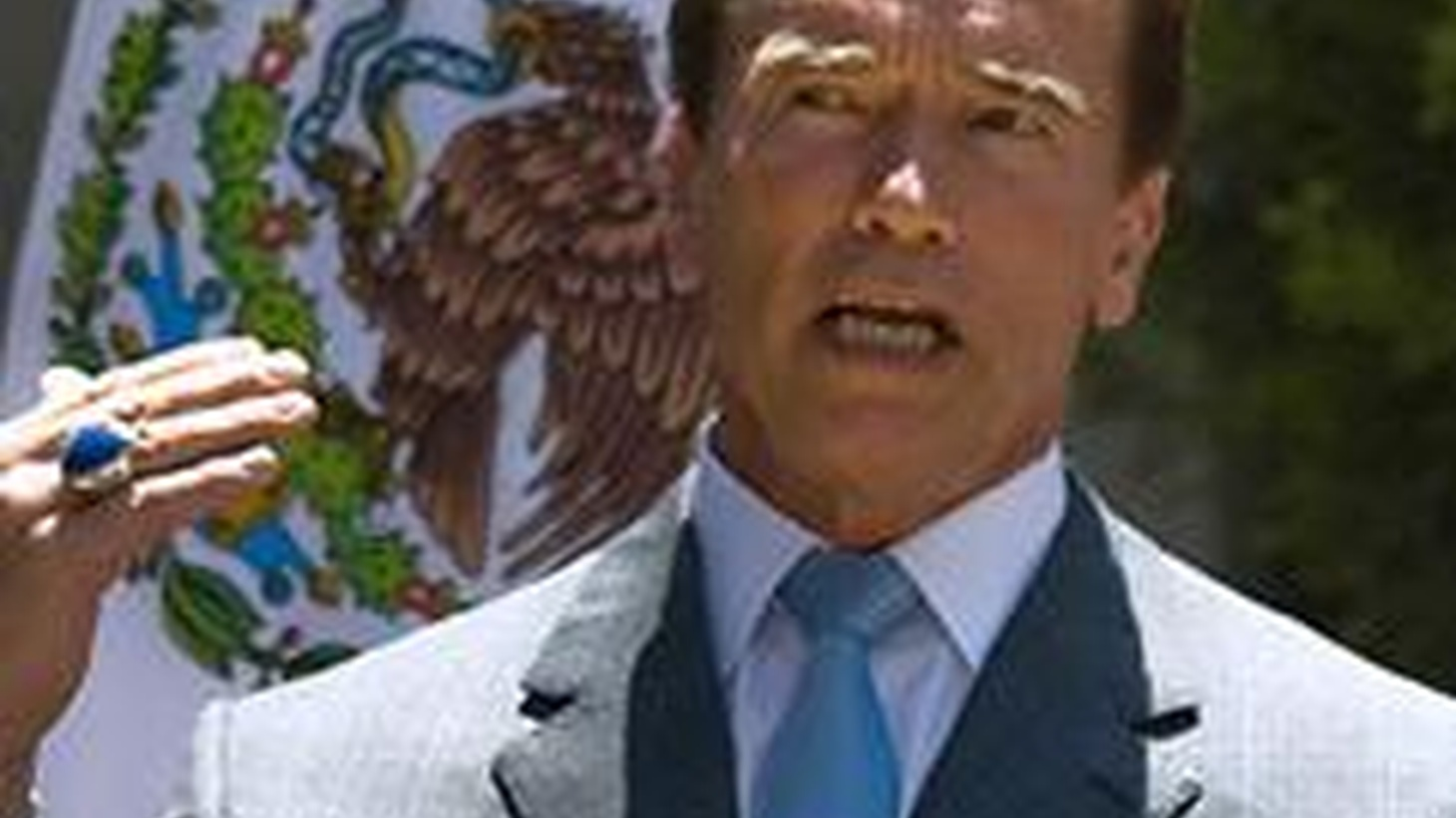 In the recall election against Gray Davis, Arnold Schwarzenegger promised to end the annual budget crisis once and for all. But once again this year there's no state budget, and the revenue shortfall is $15 billion.  Schwarzenegger's public opinion rating has dropped to 40% and the legislature's is much lower than that. Now Schwarzenegger says he's cutting the salaries of state workers—down to the federal minimum wage.