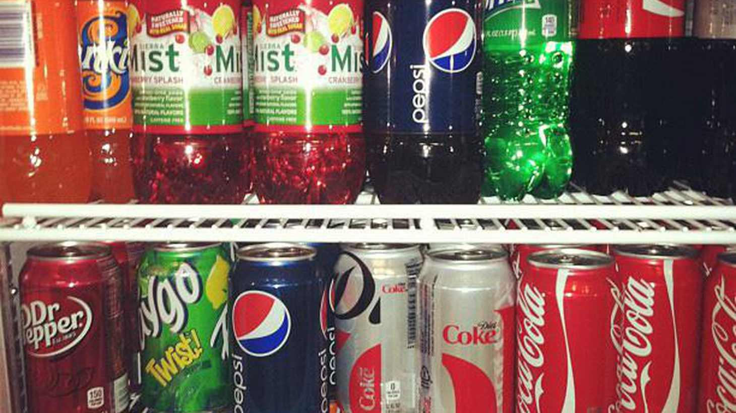 Coke, Pepsi and other beverage companies are fighting a proposed mandate in California for labels warning that sugary soft drinks increase the risk of childhood obesity.