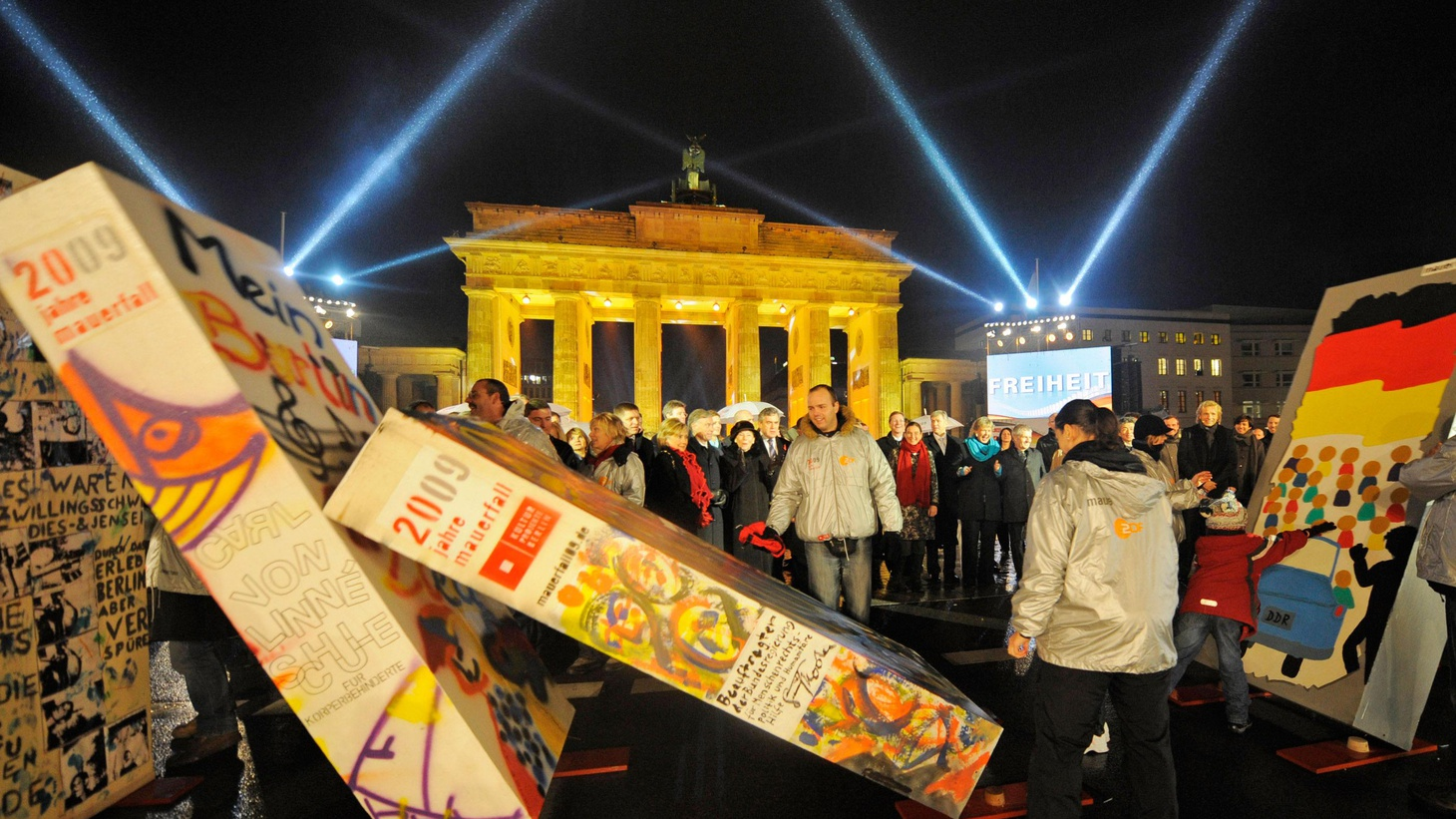 There are huge celebrations in Berlin, as world leaders gather to mark an event that changed the face of the world. It was twenty years ago today that the Berlin Wall came down. In this rebroadcast of today's To the Point, guest host Sara Terry asks whether the past two decades have lived up to the promise of that moment, and how the end of the Cold War era shaped the political and economic realities of today. Also, the Supreme Court considers life sentences for children, and why pro-choice activists are upset with the vote on healthcare reform.